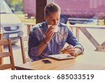 casual bearded male drinks... | Shutterstock . vector #685033519