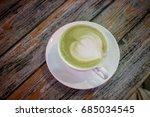 hot green tea latte   Shutterstock . vector #685034545