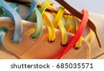 Small photo of White shoes with colorful shoe lace.