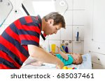 loving father changing diaper... | Shutterstock . vector #685037461
