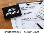 Small photo of Now hiring sign with job application for hiring concept