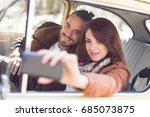young couple on a road trip ... | Shutterstock . vector #685073875