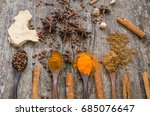 Small photo of Herbs and spices on a wooden board,Spice spoon.