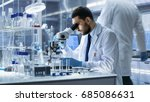research scientist looks into... | Shutterstock . vector #685086631