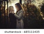 a romantic walk. couple in love   Shutterstock . vector #685111435