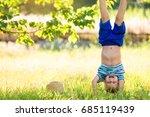 boy standing upside down on his ... | Shutterstock . vector #685119439