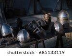 medieval helmets on a wooden... | Shutterstock . vector #685133119