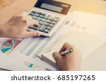 woman hand using calculator and ... | Shutterstock . vector #685197265