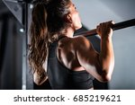 woman athlete doing pull ups | Shutterstock . vector #685219621