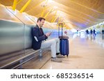young man waiting and using... | Shutterstock . vector #685236514