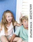 brother and sister cuddling on... | Shutterstock . vector #685257499