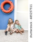 brother and sister cuddling on... | Shutterstock . vector #685257511