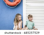 brother and sister cuddling on... | Shutterstock . vector #685257529