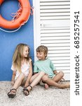 brother and sister cuddling on... | Shutterstock . vector #685257541