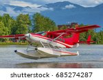 a red and white seaplane takes... | Shutterstock . vector #685274287
