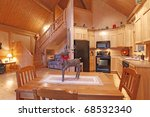 Log cabin dining room and living room - stock photo
