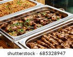Stock photo catering buffet food dish with meat and colorful vegetables on a table 685328947