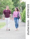 man and woman walking down... | Shutterstock . vector #685346131