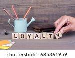 loyalty. wooden letters on dark ... | Shutterstock . vector #685361959