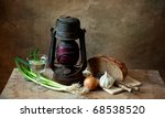 Still life with lamp and various organic vegetables with bread - stock photo
