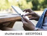 asian woman using tablet pc on... | Shutterstock . vector #685395061