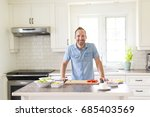 a couple in the kitchen doing... | Shutterstock . vector #685403569