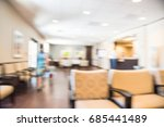 Small photo of Blurred cashier counter of primary care for preventive health care and treatment of acute, chronic illnesses in Texas, US. Abstract background of patient waiting area at medical center hospital office