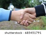 handshake in nature | Shutterstock . vector #685451791