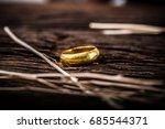 golden ring on wooden... | Shutterstock . vector #685544371