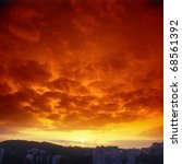 Ominous Crimson Sunset Over A...