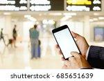 man using smartphone at flight... | Shutterstock . vector #685651639