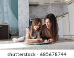 mother and daughter reading... | Shutterstock . vector #685678744