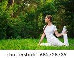 young girl doing yoga outdoor   Shutterstock . vector #685728739