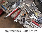 A selection of tools on dirty ground - stock photo