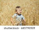 little boy in a wheat field | Shutterstock . vector #685790509