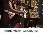 Man Playing Harmonium Keyboard...