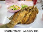 Small photo of fried snapper fish