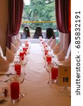 Small photo of PENANG, MALAYSIA - Circa May 2017: A long table is set with glasses and napkins for an occasion in one of the rooms of the beautifully restored colonial era Suffolk House.