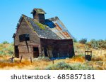 An Old Wooden Barn Sagging...