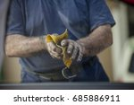 the man is wiping his dirty... | Shutterstock . vector #685886911