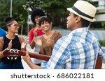 joyful listening young people... | Shutterstock . vector #686022181