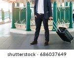 business traveler pulling... | Shutterstock . vector #686037649