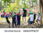 Small photo of KANCHANABURI THAILAND - JAN 22, 2016 : Young people playing a team to Team building on January 22, 2016 in Kanchanaburi, Thailand