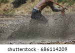 Small photo of Buffalo jockey run in mud field at Traditional buffalo race rake in mud field festival in Chonburi province ,Thailand .This even always set before rice planting season express importance of buffaloes