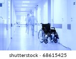 Wheel Chair At Corridor Of...