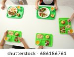 Stock photo children sitting at table in school cafeteria while eating lunch 686186761