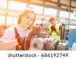 mature female worker working on ... | Shutterstock . vector #686192749