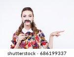 surprised winking model girl... | Shutterstock . vector #686199337