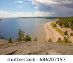 Rock With Pine Trees Near A...
