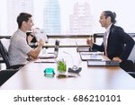 business people discussing the... | Shutterstock . vector #686210101